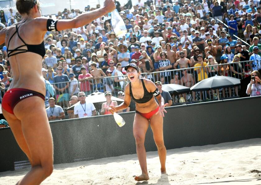 Sarah Pavan, left, and Melissa Humana-Paredes celebrate after winning the Manhattan Beach Open women's title on Sunday.