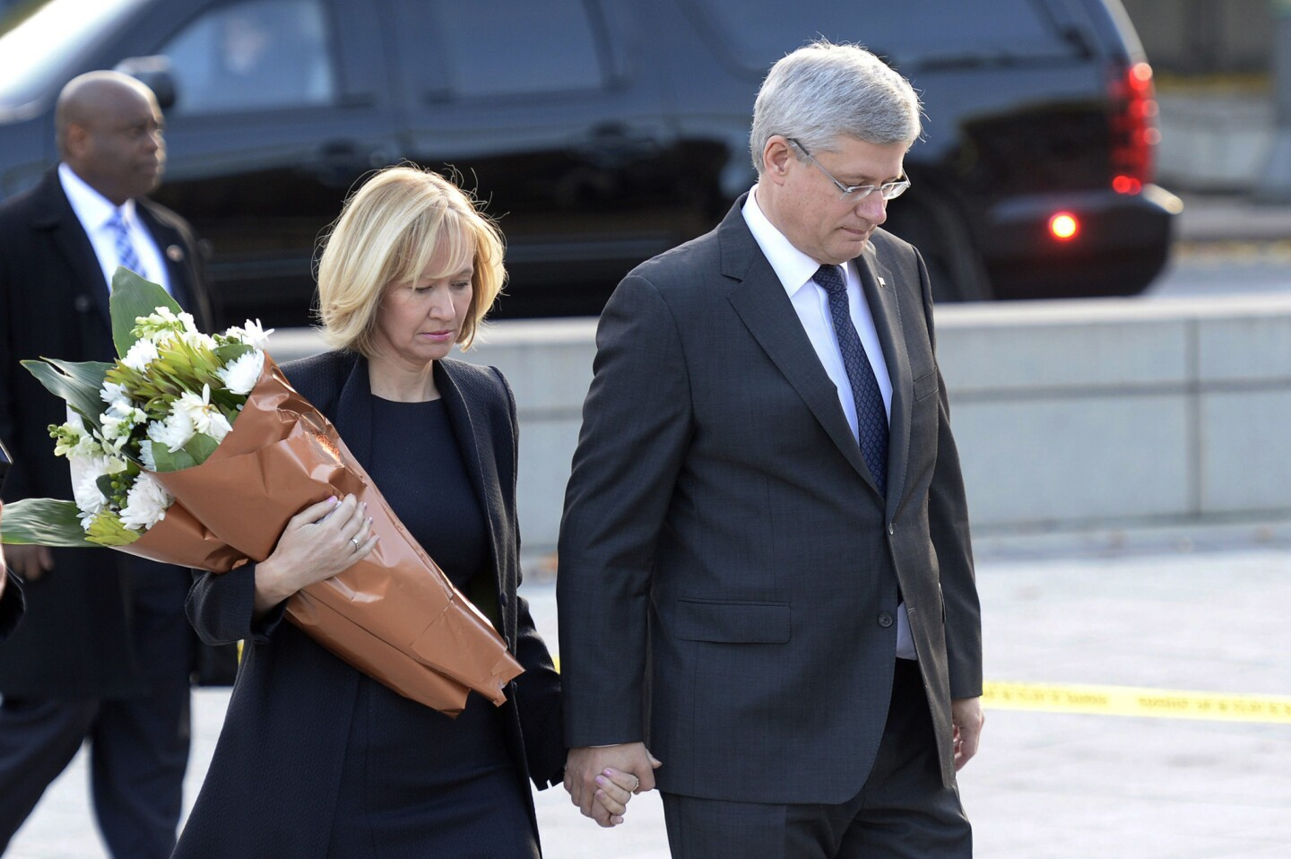 Prime Minister Stephen Harper and his wife, Laureen, visit Canada's Tomb of the Unknown Soldier in Ottawa on Oct. 23, the day after Cpl. Nathan Cirillo was killed by a gunman.