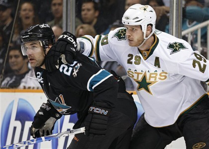 Dallas Stars' Steve Ott, right, and San Jose Sharks' Dan Boyle work for position during the first period of an NHL hockey game Thursday, March 31, 2011, in San Jose, Calif. (AP Photo/Ben Margot)
