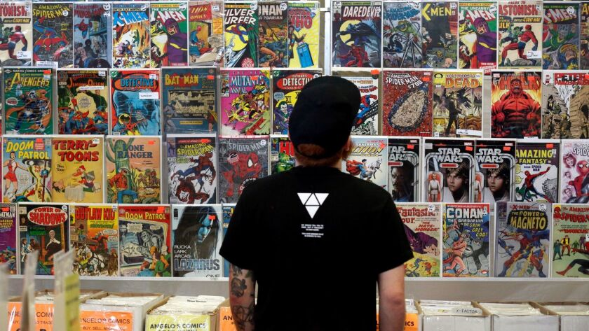 "Ryan ""Rabitt' Bunting looks over comic books at Angelo's Comics during the San Diego Comic Fest."
