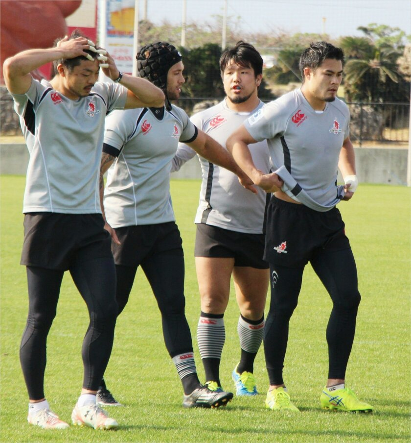 In this Thursday, Feb. 18, 2016, photo, Japan's Sunwolves captain Shota Horie, second right, speaks to his teammates during their training at Yomitanson, Okinawa prefecture, southwestern Japan. Super Rugby will embark in 2016 on a daring push into new territories which organizers say will excite fa