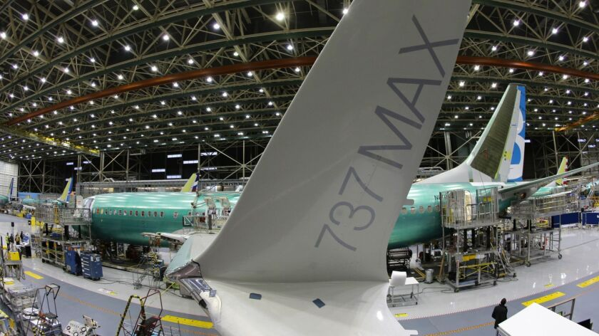 The distinctive winglet on the second Boeing 737 MAX airplane is shown through a fisheye lens. The plane was built in December 2015 on an assembly line in Renton, Wash.