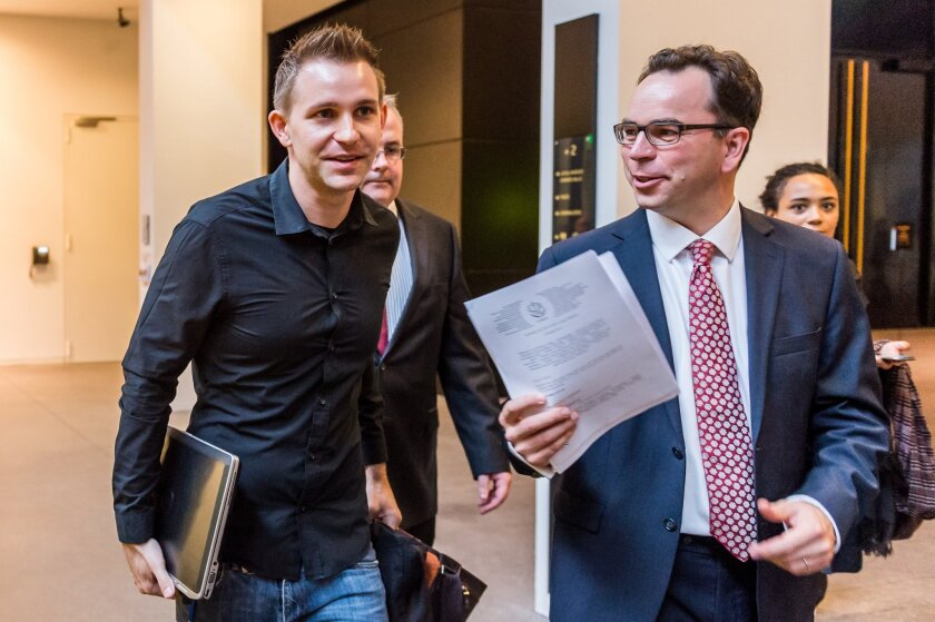 Max Schrems, left, and his lawyer Herwig Hofmann, right, walk in the hallway at the European Court of Justice in Luxembourg on Tuesday.