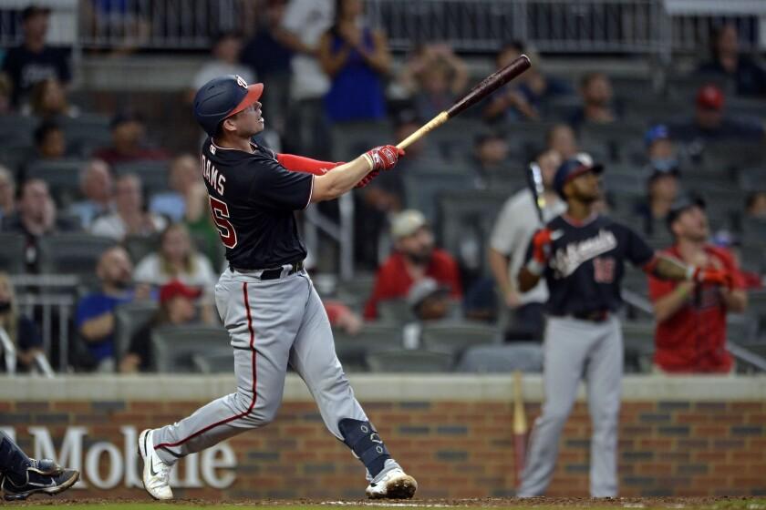 Washington Nationals' Riley Adams hits a game winning two-run home run in the ninth inning of a baseball game against the Atlanta Braves on Saturday, Aug. 7, 2021, in Atlanta. (AP Photo/Edward Pio Roda)