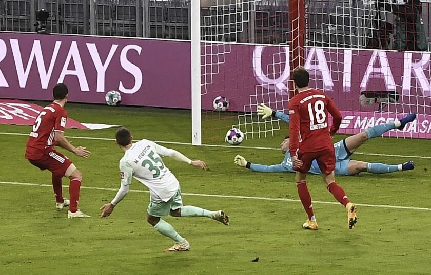 Bremen's Maximilian Eggestein scores the opening goal next to Bayern's goalkeeper Manuel Neuer during the German Bundesliga soccer match between FC Bayern Munich and SV Werder Bremen, in Munich, Germany, Nov.21, 2020. (Lukas Barth/Pool via AP)