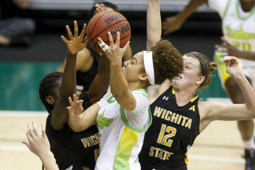South Florida guard Elena Tsineke (5) goes for the basket during the first half of an NCAA college basketball game against Wichita State, Wednesday, Jan. 6, 2021 in Tampa, Fla. (Ivy Ceballo/Tampa Bay Times via AP)