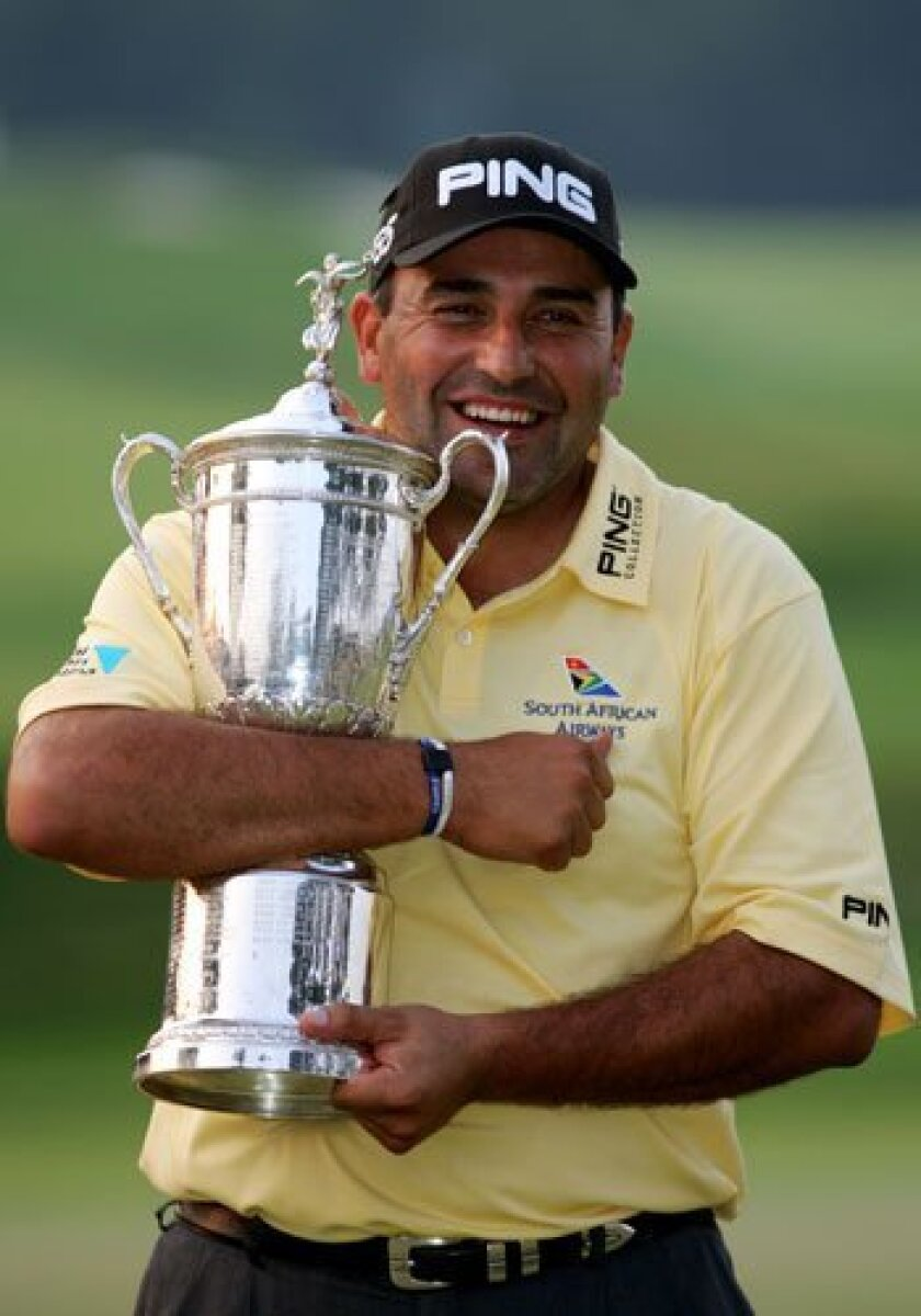 Angel Cabrera isn't letting go of that trophy as he celebrates last year's U.S. Open win at Oakmont.