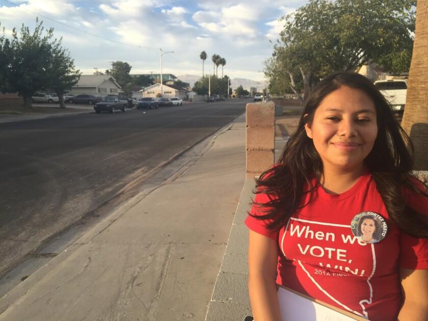 Immigrant Miriam Cadenas, 19, encourages Latino voters to go to the polls in Las Vegas.