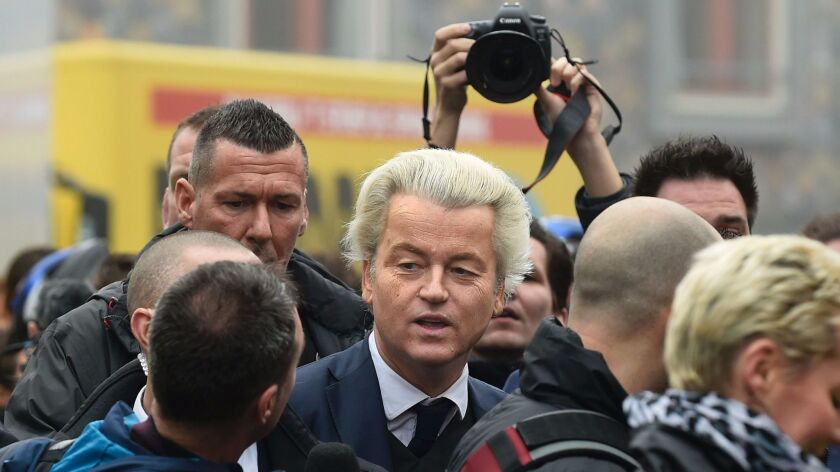 Dutch far-right politician Geert Wilders, center, addresses journalists as he launches his parliamentary election campaign in Spijkenisse on Feb. 18, 2017.