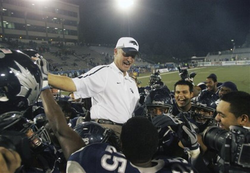 Nevada Wolf Pack head coach Chris Ault sits on the shoulders of his players after the NCAA college football game in celebration of his 200th win at Mackay Stadium in Reno, Nev., on Friday, Oct. 9, 2009. Nevada beat Louisiana Tech 37-14. (AP Photo/Brad Horn)
