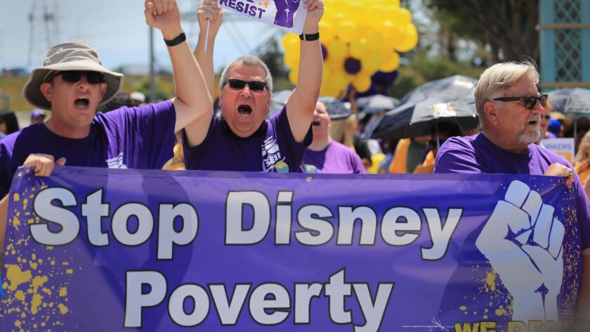 Disneyland workers rally for higher wages at the park entrance in Anaheim on July 3.