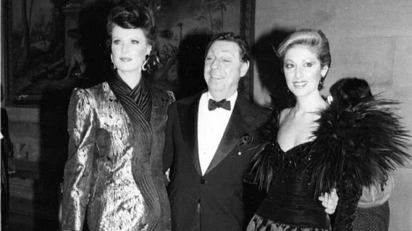 James Galanos, center, at the 1983 Metropolitan Museum of Art Costume Institute Gala.
