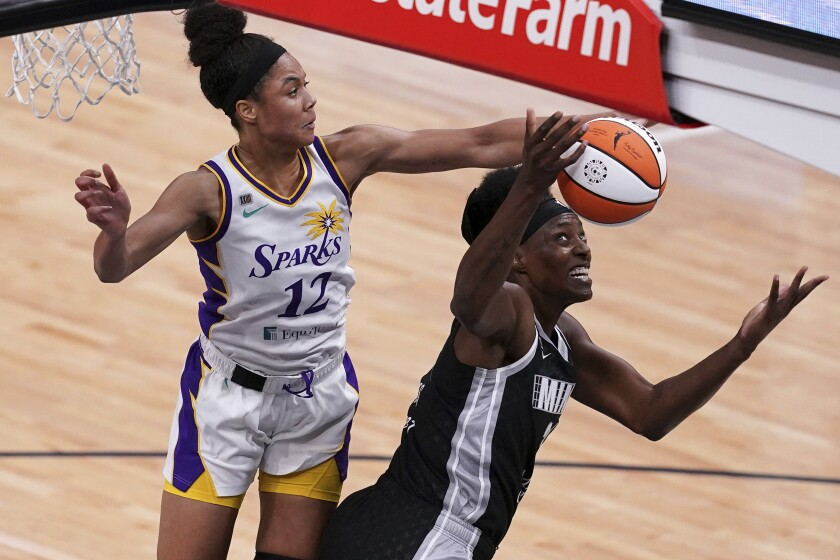 Los Angeles Sparks forward Nia Coffey (12) collides with Minnesota Lynx center Sylvia Fowles (34) during the second quarter of a WNBA basketball game Saturday, June 12, 2021, in Minneapolis. (Anthony Souffle/Star Tribune via AP)