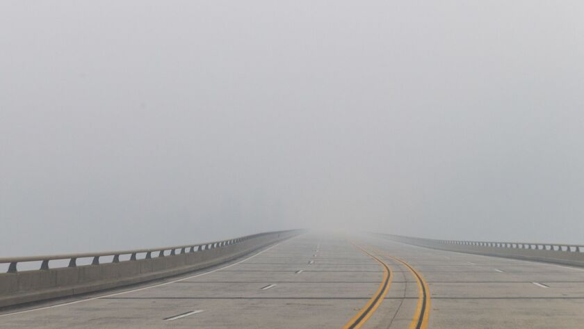 CONCOW, CALIF. - NOVEMBER 14: Smoke from the Camp Fire obscrues the view of highway 70, near the Con