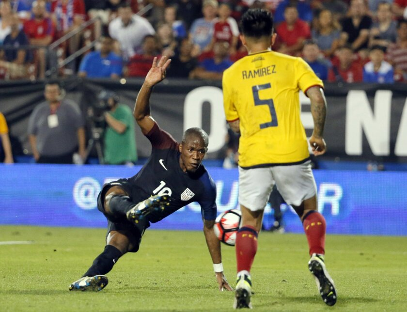 CORRECTS TO DARLINGTON NAGBE, INSTEAD OF NAGBE DARLINGTON - U.S. midfielder Darlington Nagbe takes a shot and scores in front of Ecuador's Christian Ramirez (5) during the second half of an exhibition soccer match, Wednesday, May 25, 2016, in Frisco, Texas. The United States won 1-0. (AP Photo/Tony