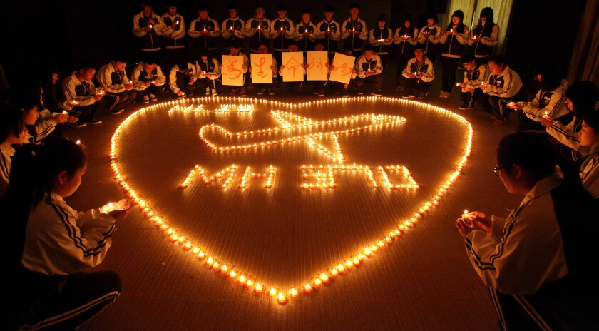 Students from an international school in Zhuji, China, pray for the passengers of Malaysia Airlines Flight 370 at a candlelight vigil in March.