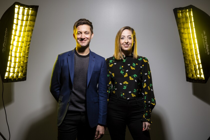 "Chris Kelly, left, and Sarah Schneider at the Comedy Central offices in Hollywood on Jan. 11. The former ""Saturday Night Live"" head writer duo are the creators of a new Comedy Central series, ""The Other Two,"" about the struggling adult siblings of a teenage YouTube celebrity."