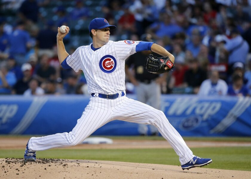 Chicago Cubs starting pitcher Kyle Hendricks delivers during the first inning of a baseball game against the Pittsburgh Pirates on Tuesday, Aug. 30, 2016, in Chicago. (AP Photo/Charles Rex Arbogast)