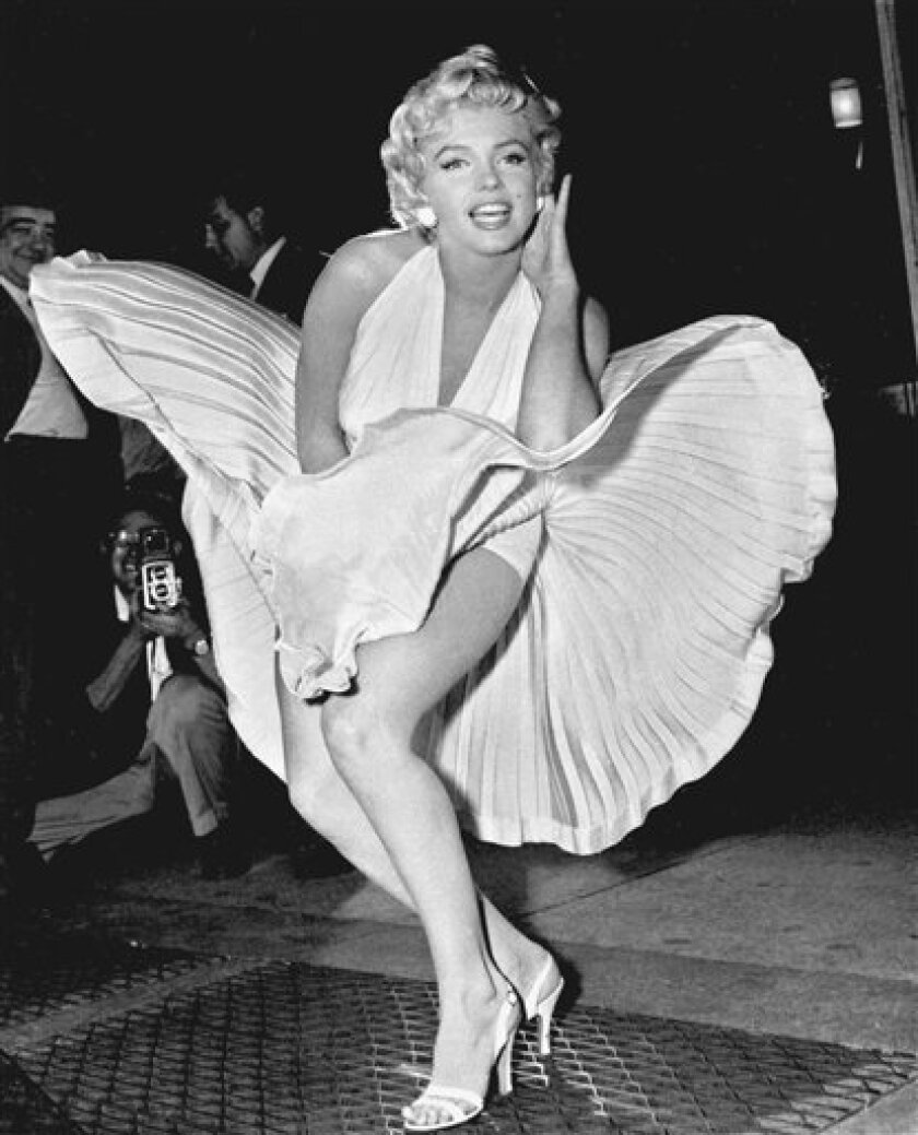 """In this Sept. 9, 1954 file photo, Marilyn Monroe poses over the updraft of a New York subway grating while in character for the filming of """"The Seven Year Itch"""" in New York.(AP Photo/Matty Zimmerman, file)"""