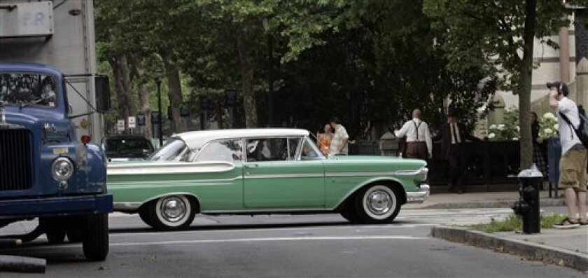 FILE - In this file photo taken June 28, 2007, a 1950s vintage Mercury Montclair auto waits on College Street in New Haven, Conn. Ford Motor Co. is assessing the future of Mercury, although a final decision on whether to kill the brand hasn't yet been made, a person familiar with the company's deliberations said Thursday, May 27, 2010. (AP Photo/Bob Child, File)