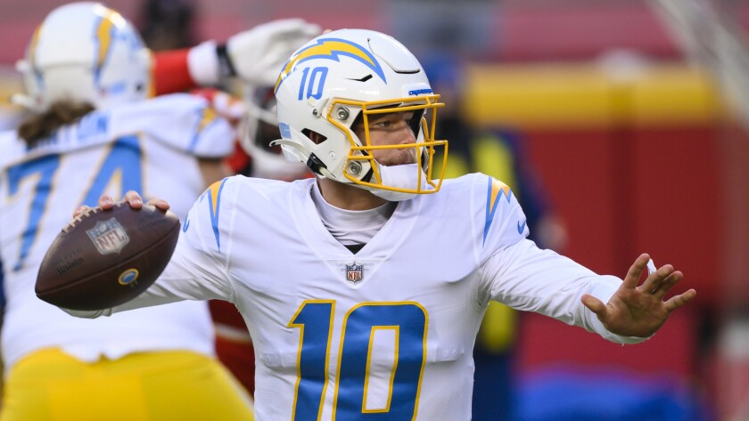 Chargers quarterback Justin Herbert looks to pass during a game against the Kansas City Chiefs