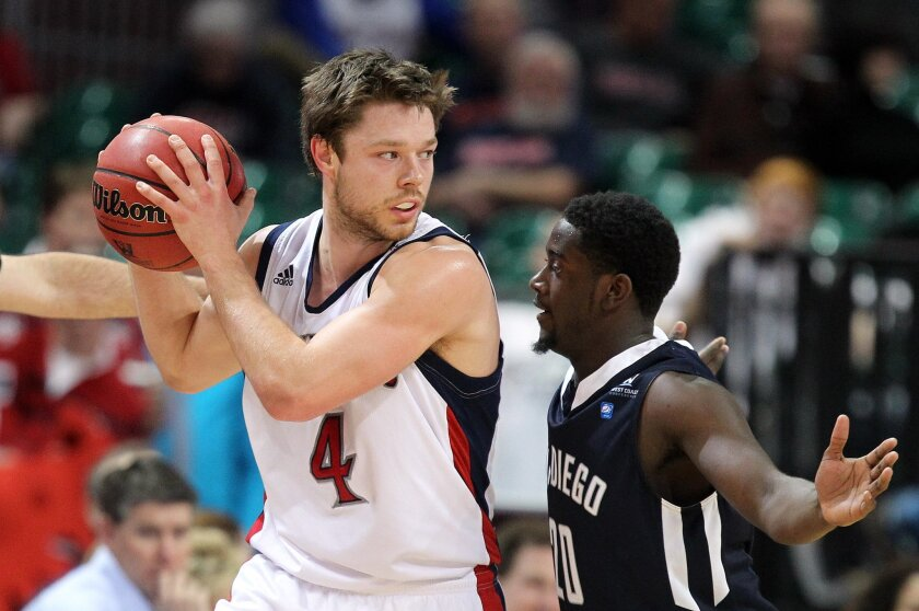 Matthew Dellavedova, who was held to seven points but had 12 assists, tried to fend off the defense of Torero Cameron Miles. Dellavedova hit a late 3-pointer to send the game to overtime.