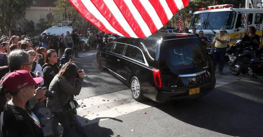 The hearse carrying the body of a police officer, Sgt. Ron Helus, leaves Los Robles Hospital in Thousand Oaks, California, USA, on Nov. 8, 2018. Thirteen people were killed and several were wounded in the mass shooting at the Borderline Bar & Grill. Authorities said the gunman killed 12 people inside the establishment, including Helus, before committing suicide. EPA-EFE/MIKE NELSON