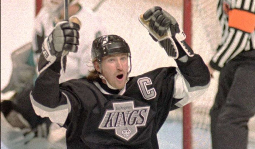 Wayne Gretzky celebrates after scoring a goal for the Kings in 1994.