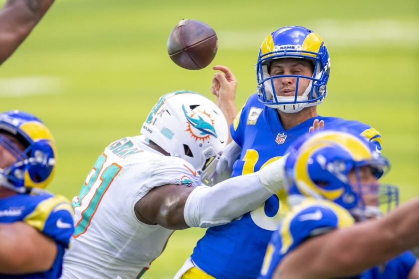 Dolphins defensive end Emmanuel Ogbah (91) hits Rams quarterback Jared Goff (16), causing a fumble Nov. 1, 2020.