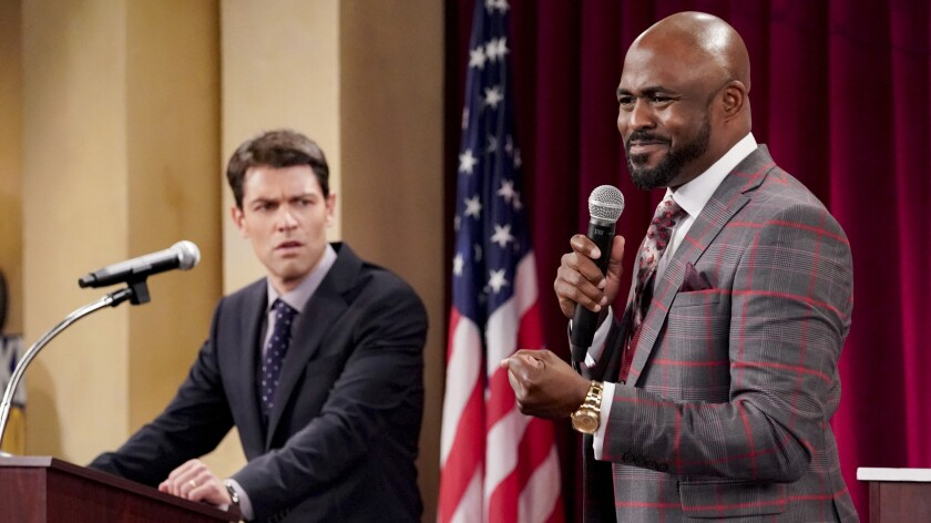 """Max Greenfield and Wayne Brady at a candidate forum on CBS' """"The Neighborhood."""""""