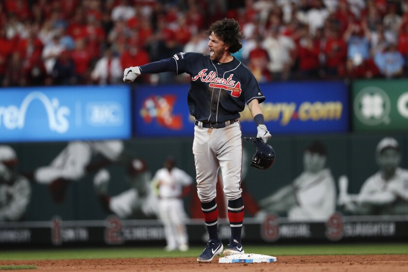 Atlanta Braves' Dansby Swanson celebrates after hitting an RBI-double during the ninth inning in Game 3 of a baseball National League Division Series against the St. Louis Cardinals, Sunday, Oct. 6, 2019, in St. Louis. (AP Photo/Jeff Roberson)