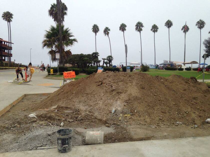 Materials pile up in front of Kellogg Park in La Jolla Shores awaiting construction crews.