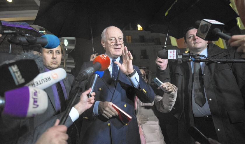 United Nations envoy Staffan de Mistura, center, speaks to the press. The media's use of schoolyard tactics in covering the Syria peace talks in Geneva has brought a measure of decidedly un-Swiss-like chaos to the U.N. headquarters.