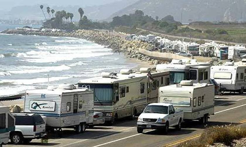 RVs gather at Rincon in Ventura County. Comfort is trumping fuel costs. RV rentals rose 22% this year.