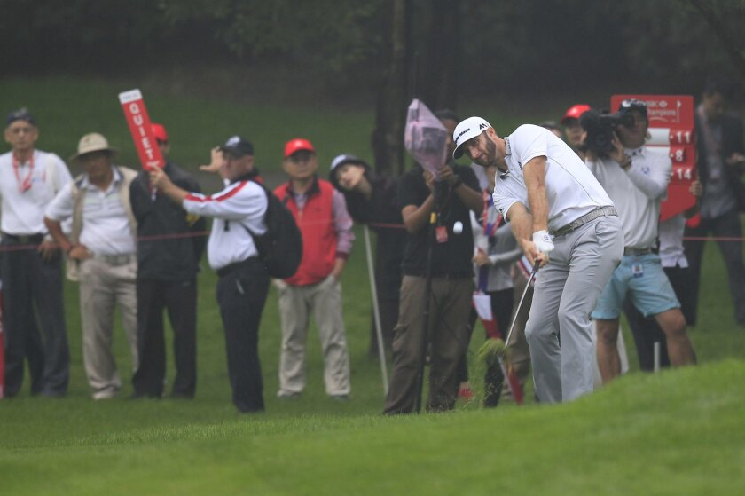 Dustin Johnson of the United States hits a shot on the 16th hole during the third round of the HSBC Champions golf tournament at the Sheshan International Golf Club in Shanghai, China Saturday, Nov. 7, 2015. (AP Photo)