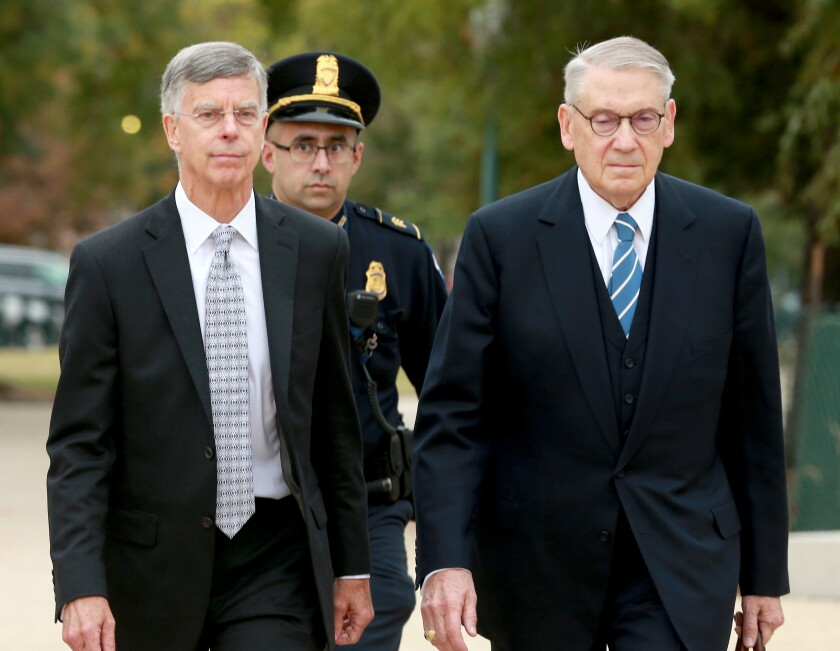 William B. Taylor, left, the top U.S. diplomat to Ukraine, arrives at the Capitol on Tuesday to testify.