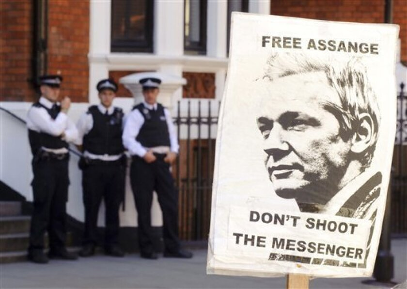 A pro-Julian Assange placard is seen outside the Embassy of Ecuador, in central London, Saturday August 18, 2012, where Wikileaks founder Julian Assange is claimed asylum in an effort to avoid extradition to Sweden.