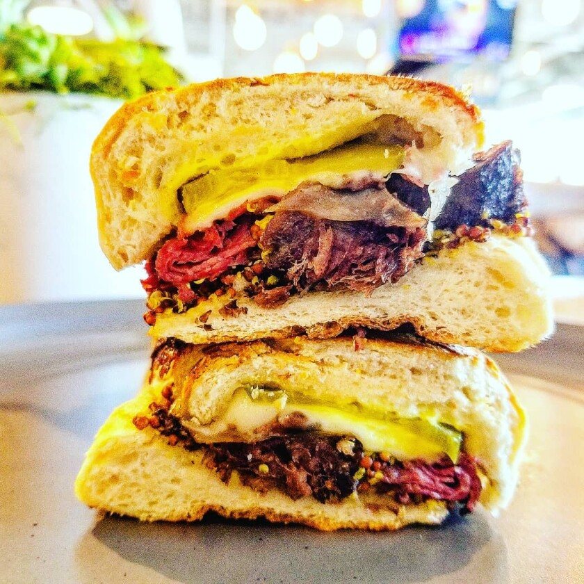 The beef Cubano sandwich at The Florence restaurant in Sabre Springs.