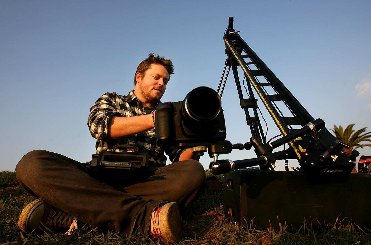 Photographer Colin Rich sets up equipment to shoot a time-lapse sequence of the sun setting on downtown Los Angeles.