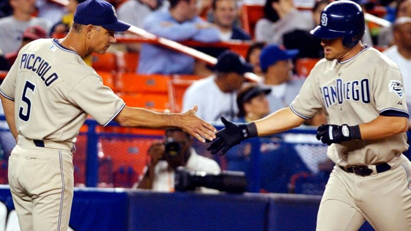 San Diego Padres Phil Nevin, right, celebrates with coach Rob Picciolo, left, after hitting a home run in the sixth inning against the New York Mets Wednesday Aug. 25, 2004 at New York's Shea Stadium.