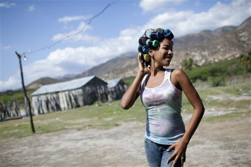Twicy poses for a picture in Jimani, Dominican Republic, Saturday, Jan. 29, 2011. (AP Photo/Rodrigo Abd)