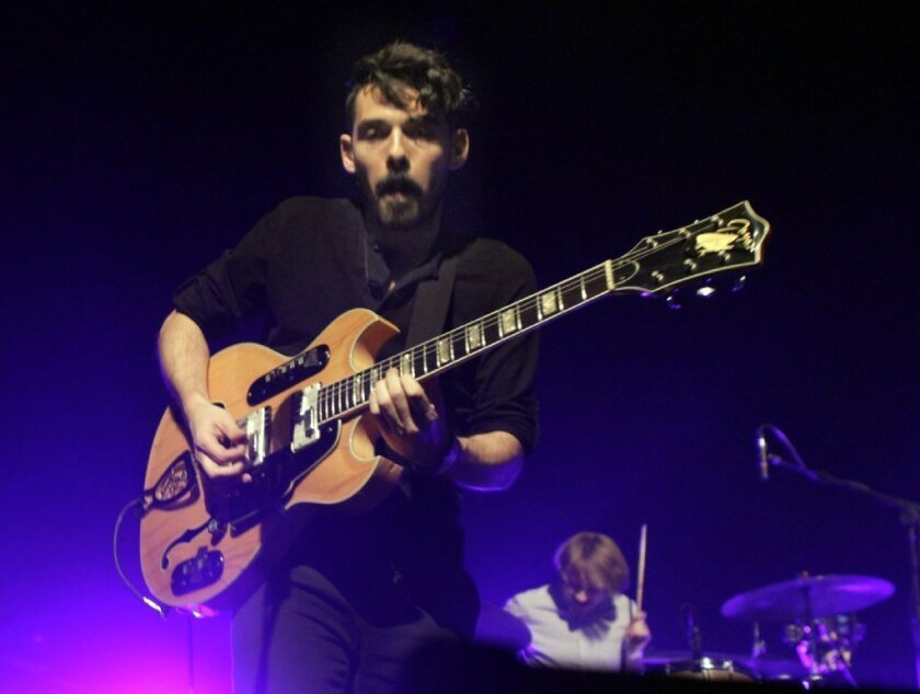 Taylor Rice, left, and Matt Frazier of the L.A. band Local Natives perform at the Fonda in Hollywood on Jan. 28, 2013.