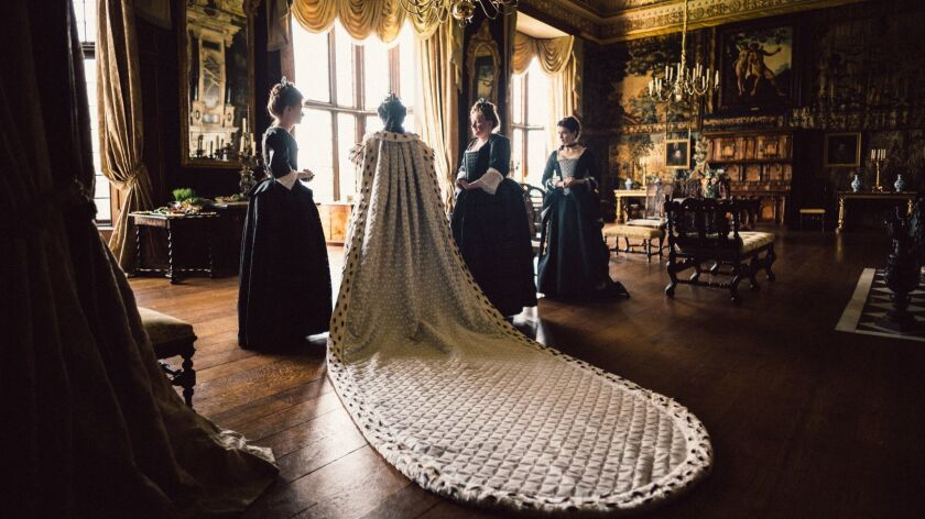 """Olivia Colman, center, and Rachel Weisz. far right, in the film """"THE FAVOURITE."""" Credit: Yorgos Lant"""