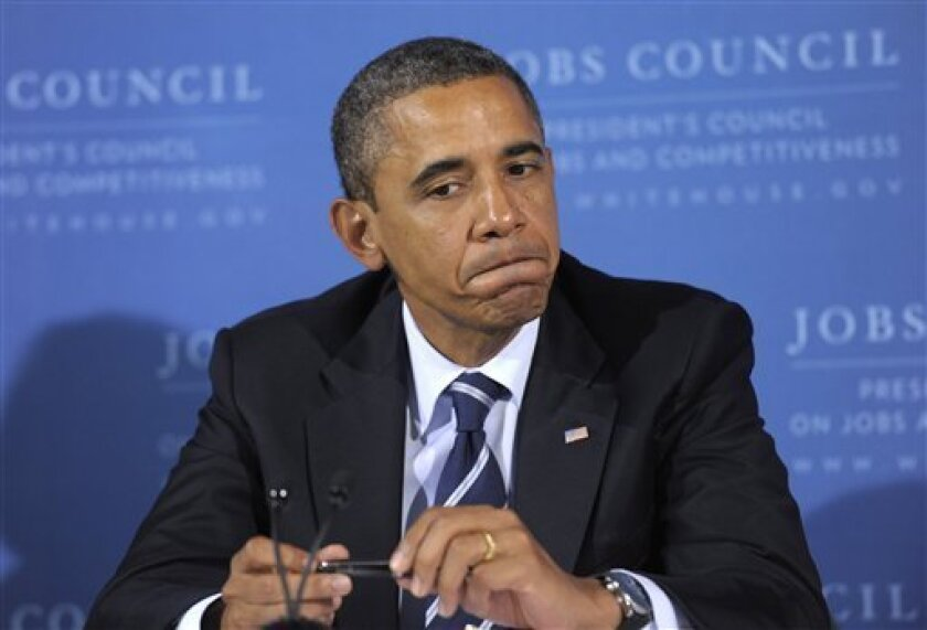 President Barack Obama listens during a meeting of the President's Council on Jobs at the International Brotherhood of Electrical Workers (IBEW) Local No. 5 Training Center in Pittsburgh, Tuesday, Oct. 11, 2011. (AP Photo/Susan Walsh)
