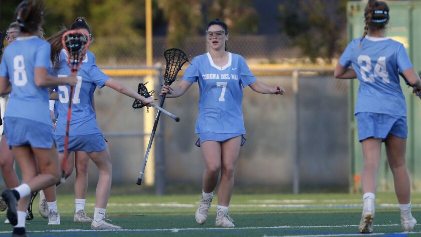 Corona del Mar's Caroline Brewster (7) is congratulated by teammates after she scored against Edison in a Sunset League game.