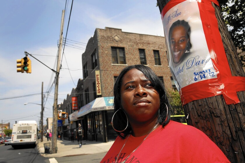 """""""The police portrayed her as a career criminal, but she was unarmed when they shot her,"""" says Natasha Duncan, standing on the Brooklyn corner where her sister Shantel Davis was killed by a police detective three years ago."""