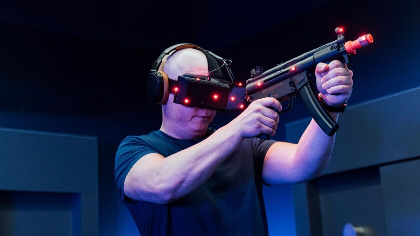 "A guest plays a virtual reality game based on Lionsgate's ""John Wick"" at Imax VR Experience Centre in Los Angeles"