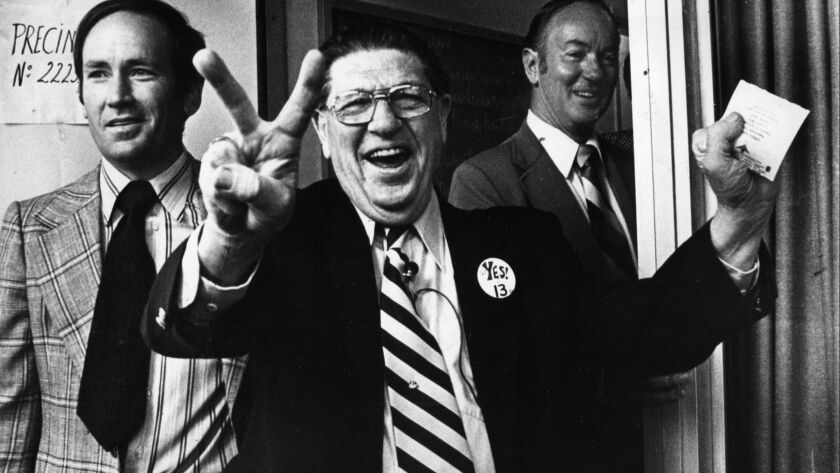Howard Jarvis, chief sponsor of the controversial Proposition 13, signals victory as he casts his vote on June 6, 1978.