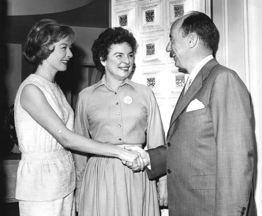Diana Lynn, left, and Mercedes McCambridge greet Adlai E. Stevenson at Miss Lynn's Beverly Hills home.