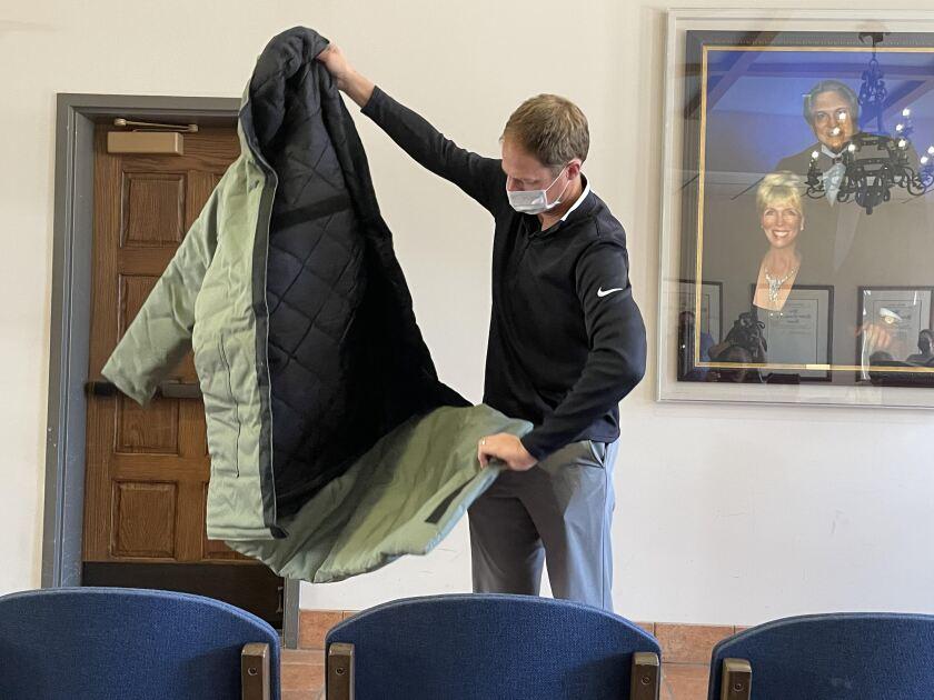 Drew Moseropens an Empowerment Plan coat that converts into a sleeping bag.